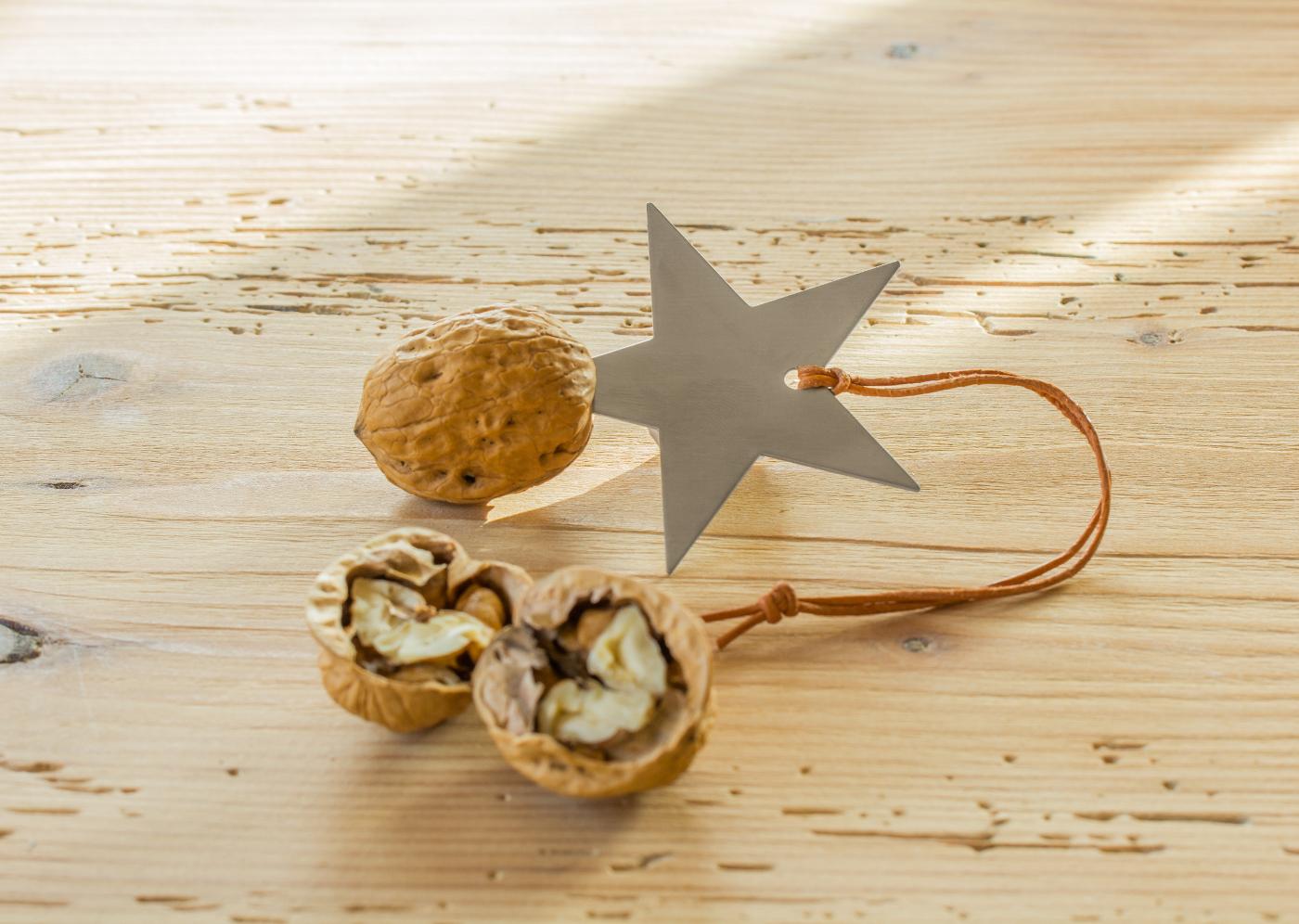 Ouvre noix étoile en inox brossé